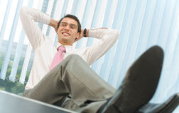 Happy businessman at office Royalty Free Stock Photography