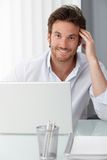 Happy businessman at office desk Royalty Free Stock Photo