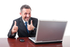 Happy businessman at office with double like gesture Royalty Free Stock Photography