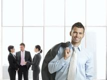 Happy businessman in office lobby Stock Photography