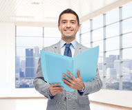 Happy businessman with open folder Stock Photo