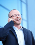 Happy businessman outside talking on cell Royalty Free Stock Photos