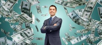 Happy businessman over dollar cash money rain Stock Photos