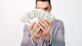 Happy businessman with packets of dollar money stock footage