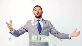 Happy businessman with packets of dollar money stock video footage