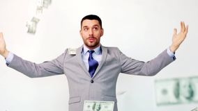 Happy businessman with packets of dollar money stock video