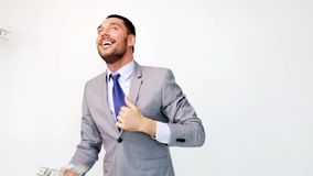 Happy businessman with packets of dollar money. Business, people and finances concept - happy businessman with packets of dollar money stock video