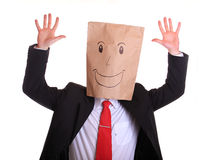 Happy businessman with a paper bag with smile on h Stock Image