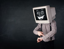 Happy businessman with a PC monitor head and a smiley face Stock Image