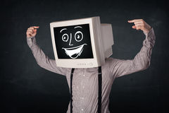 Happy businessman with a PC monitor head and a smiley face Royalty Free Stock Photos
