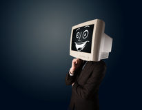 Happy businessman with a PC monitor head and a smiley face Stock Photo