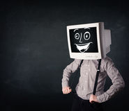 Happy businessman with a PC monitor head and a smiley face Royalty Free Stock Photo