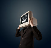 Happy businessman with a PC monitor head and a smiley face Stock Images