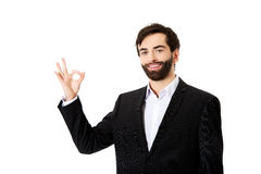 Happy businessman with perfect sign. Royalty Free Stock Photography