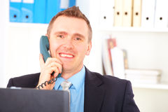 Happy businessman on the phone Royalty Free Stock Images