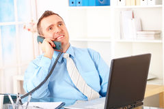 Happy businessman on the phone Stock Photo