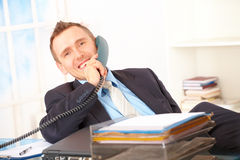 Happy businessman on the phone Royalty Free Stock Photo