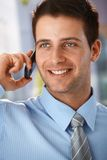 Happy businessman on phone call. Closeup portrait of handsome happy businessman on mobile phone call Stock Image