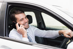 Happy businessman on the phone. In his car Stock Images