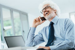 Happy businessman on the phone Royalty Free Stock Image