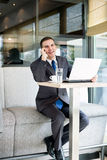 Happy businessman on phone Stock Photography