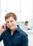 Happy businessman phoning in his office Royalty Free Stock Image