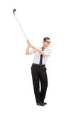 Happy businessman playing golf Royalty Free Stock Image