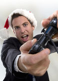 Happy businessman playing video game Stock Photos