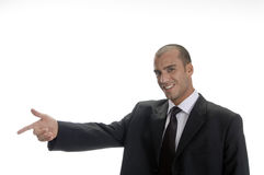 Happy businessman pointing Stock Photos