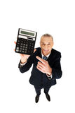 Happy businessman pointing on calculator Stock Photography