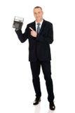 Happy businessman pointing on calculator Stock Photos