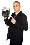Happy businessman pointing on calculator Royalty Free Stock Photography