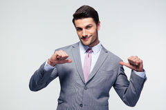 Happy businessman pointing at herself Royalty Free Stock Photos
