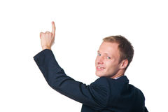 Happy businessman pointing with his finger Royalty Free Stock Photography