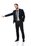 Happy businessman pointing his finger. Stock Photography