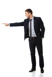Happy businessman pointing his finger. Happy handsome businessman pointing to the left Stock Image