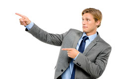 Happy businessman pointing isolated on white background Royalty Free Stock Photo