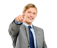 Happy businessman pointing isolated on white background Royalty Free Stock Image