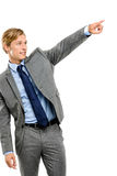 Happy businessman pointing isolated on white background Stock Image