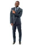 Happy businessman pointing at something Royalty Free Stock Images