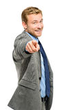 Happy businessman pointing on white background Royalty Free Stock Images