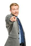 Happy businessman pointing on white background Stock Images
