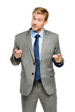 Happy businessman pointing on white background Royalty Free Stock Photography