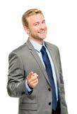 Happy businessman pointing on white background Stock Photo