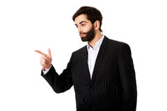 Happy businessman points his finger. Royalty Free Stock Photos