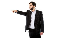 Happy businessman points his finger. Stock Photography