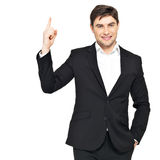 Happy businessman points his finger up Royalty Free Stock Images