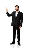 Happy businessman points his finger up. Stock Image