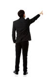 Happy businessman points his finger up. Stock Photo