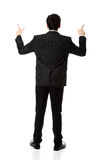 Happy businessman points his finger up. Royalty Free Stock Images
